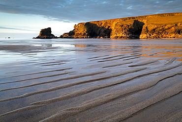 Low tide on a deserted Porthcothan Beach, Cornwall, England, United Kingdom, Europe