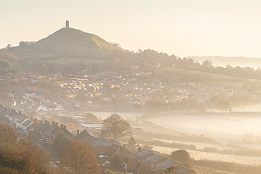 Vista over Glastonbury towards Glastonbury Tor on a misty winter morning, Somerset, England, United Kingdom, Europe