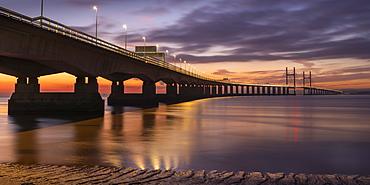 Twilight over an illuminated Prince of Wales Bridge, Gloucestershire, England, United Kingdom, Europe