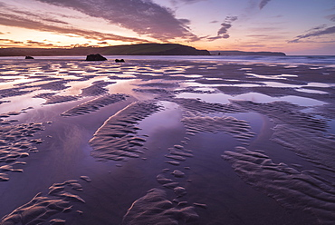 Pink sunrise skies in winter above the sandy beach at Bigbury-on-Sea, South Hams, Devon, England, United Kingdom, Europe
