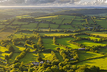 Aerial view by drone of rolling countryside in evening light, Devon, England, United Kingdom, Europe
