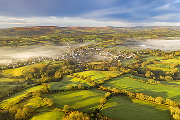Aerial vista by drone of rolling countryside surrounding the village of Moretonhamstead in winter, Devon, England, United Kingdom, Europe