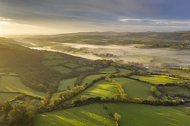 Aerial vista by drone of rolling countryside at dawn in winter, Devon, England, United Kingdom, Europe