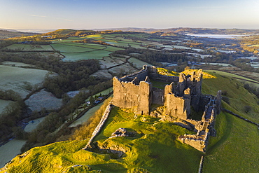 Aerial vista by drone of Carreg Cennen Castle, Brecon Beacons National Park, Carmarthenshire, Wales, United Kingdom, Europe
