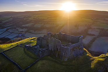 View by drone of sunrise over Carreg Cennen Castle in winter, Brecon Beacons National Park, Carmarthenshire, Wales, United Kingdom, Europe