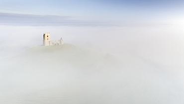 Burrow Mump Church surrounded by morning mist in winter, Burrowbridge, Somerset, England, United Kingdom, Europe