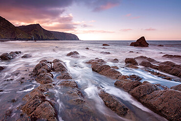 Sunset over Mouthmill Beach on the North Devon coast, England.