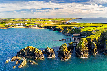 Aerial vista of Merope Rocks, Padstow Lifeboat Station and Mother Ivey???s Bay, Cornwall, England. Summer (July) 2020.