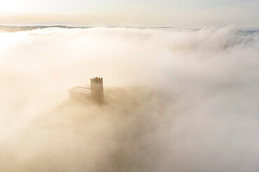 Brentor Church surrounded by morning mist in autumn, Dartmoor, Devon, England, United Kingdom, Europe