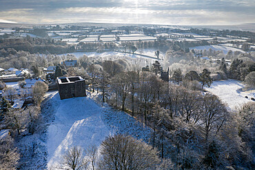 Aerial view of Lydford Castle on a snowy winter morning, Lydford, Devon, England. Winter (January) 2021.