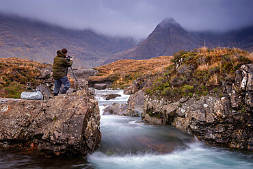 Male photographer at the Fairy Pools on the Isle of Skye, Inner Hebrides, Scotland, United Kingdom, Europe