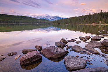 Sunrise on a beautiful reflective lake in the Canadian Rockies, Jasper National Park, UNESCO World Heritage Site, Alberta, Canada, North America