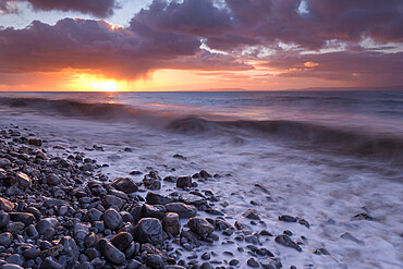 Sunrise over the sea at Llantwit Major in winter, Glamorgan, Wales, United Kingdom, Europe