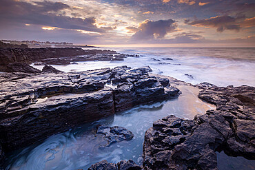 Sunrise over the dramatic rocky coastline of Porthcawl in winter, South Wales, United Kingdom, Europe
