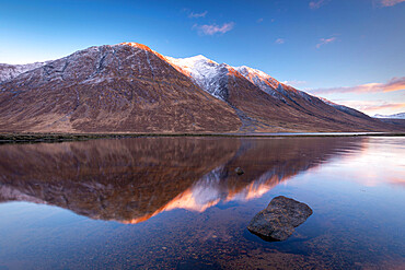Snow capped Highlands mountains reflected in the calm waters of Loch Etive in winter, Highlands, Scotland, United Kingdom, Europe
