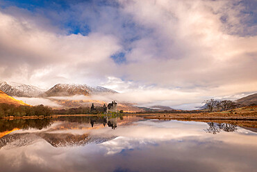 Kilchurn Castle reflected in Loch Awe at dawn in winter, Highlands, Scotland, United Kingdom, Europe