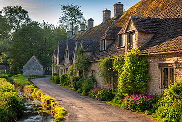 Early Spring morning view of the beautiful Cotswolds cottages at Arlington Row in Bibury, Gloucestershire, England. Spring (May) 2019.