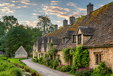 Early Spring morning view of the beautiful Cotswolds cottages at Arlington Row in Bibury, Gloucestershire, England, United Kingdom, Europe