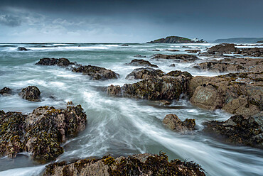 Stormy conditions on the rocky Bantham coast, looking across to Burgh Island, Devon, England, United Kingdom, Europe