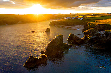 Summer sunrise over Porthcothan Bay on the North Cornwall coast, Cornwall, England, United Kingdom, Europe