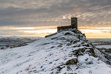 Brentor Church on a snowy outcrop on a winter morning, Dartmoor, Devon, England. Winter (January) 2021.