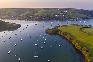 Aerial vista of the Kingsbridge Estuary at dawn, Salcombe, South Hams, Devon, England. Spring (April) 2019.