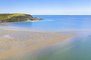 Aerial photograph of the Doom Bar emerging from the Camel Estuary at low tide, Padstow, Cornwall, England. Spring (April) 2021.