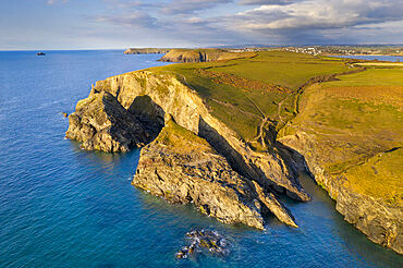 Aerial vista of Merope Islands and dramatic cliffs near Stepper Point, Padstow, Cornwall, England. Spring (April) 2021.