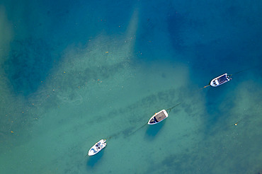 Aerial view of boats moored on the East Looe River, Looe, Cornwall, England. Spring (April) 2021.