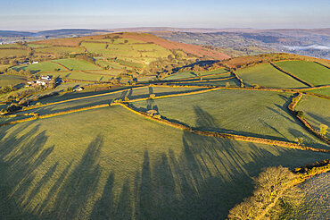 Aerial vista of rolling farmland near Chagford, Dartmoor National Park, Devon, England. Spring (April) 2021.