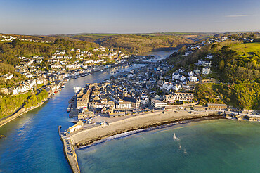 Aerial view of the beautiful Cornish fishing town of Looe on a sunny spring morning, Looe, Cornwall, England. Spring (April) 2021.