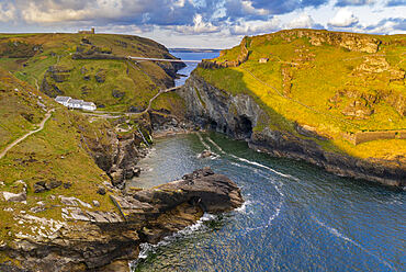 Aerial view of Tintagel Castle and bridge at dawn, Cornwall, England. Spring (May) 2021.