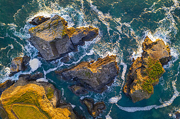 Aerial view of the Minnows islands near Porthcothan on the North coast of Cornwall, England. Spring (May) 2021.