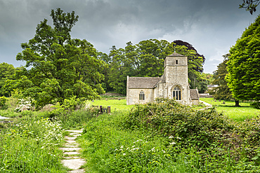 St Michael and St Martin???s Church in the Cotswolds village of Eastleach Turville, Gloucestershire, England. Spring (May) 2019.