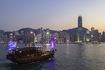 Junk boat in Victoria Harbour at dusk, Hong Kong Island, Hong Kong, China, Asia