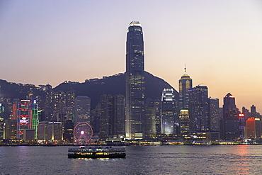 Star Ferry in Victoria Harbour at dusk, Hong Kong Island, Hong Kong, China, Asia