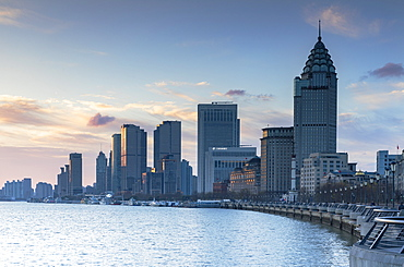 Buildings along Huangpu River at sunrise, Shanghai, China, Asia