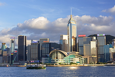 Star Ferry in Victoria Harbour with skyscrapers of Wan Chai, Hong Kong, China, Asia