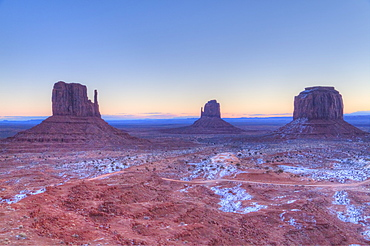 Sunrise, West Mitten Butte on left, East Mitten Butte in centre, and Merrick Butte on right, Monument Valley Navajo Tribal Park, Utah, United States of America, North America