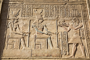 Gods Hathor on left and Haroeris in centre with Pharaoh on the right, Wall Reliefs, Temple of Sobek and Haroeris, Kom Ombo, Egypt, North Africa, Africa
