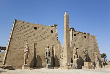 Six Colossi of Ramses II in front of Pylon, Obelisk, Luxor Temple, UNESCO World Heritage Site, Luxor, Thebes, Egypt, North Africa, Africa