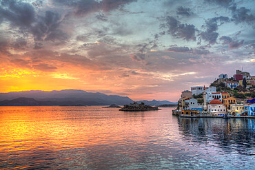 Sunrise, buildings at Harbour Entrance, Kastellorizo (Megisti) Island, Dodecanese Group, Greek Islands, Greece, Europe