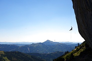 A climber ascends a rope on the cliffs of Ceuse, a mountain in the Alpes Maritimes, Haute Alpes, France, Europe