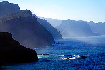 The dramatic sea cliffs of the northwest coast rise beyond the Sao Lourenco peninsula, eastern Madeira, Portugal, Atlantic Ocean, Europe