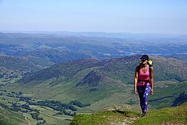 Hiker on a trail above Langdale, Lake District National Park, UNESCO World Heritage Site, Cumbria, England, United Kingdom, Europe