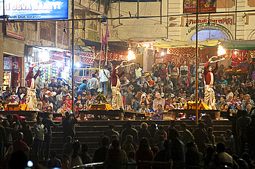 Hindu devotees taking part in the sacred ceremony of evening aati, adoration of the holy River Ganges, Varanasi, Uttar Pradesh, India, Asia