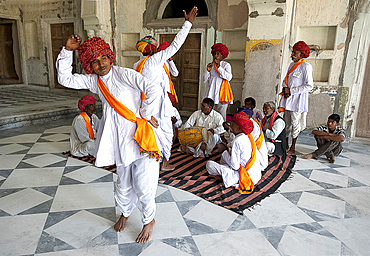 Troup of Rajasthani dancers and musicians performing traditional dance in 18th century Diggi palace Durbar Hall, Rajasthan, India, Asia