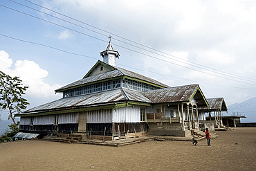 Large, wooden built Baptist church at the top of Naga tribal village, community converted from Animism to Christianity, Nagaland, India, Asia
