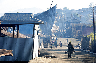 Naga villagers in the early morning, going about their business in Chanlangshu Naga village, Nagaland, India, Asia
