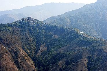One of the countless hilltop Naga villages in the verdant Naga hills, Baptist church at its peak, Nagaland, India, Asia